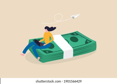 Online business making money, salary or multi income stream, side hustle or side gig earning, investment return concept, young woman working with computer laptop sitting on heap of dollar banknotes.