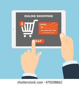 Online shopping concept. Buying products and service through Internet. Shopping cart with pay button.