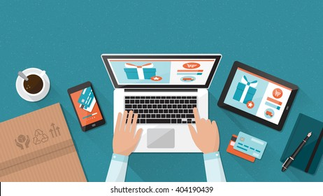 Online shopping and delivery concept, businessman purchasing products and making orders using a laptop