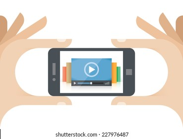 Online video movies collection player on mobile phone in human hand. Idea - Mobile collection of films (Youtube etc.), Cloud computing technologies for internet video streaming, Video TV news