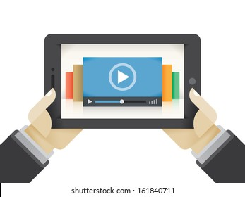 Online video service (Youtube etc.) collection of movies on tablet in human hands. Concepts: watching streaming TV, cloud computing for movie database, business video education etc.