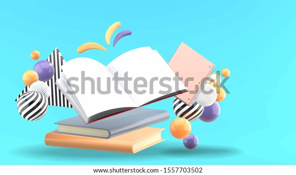 Open book and notebook surrounded by colorful ball on a blue background.