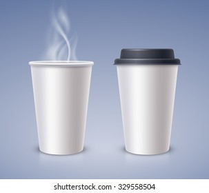 Open and closed paper cups with hot drink