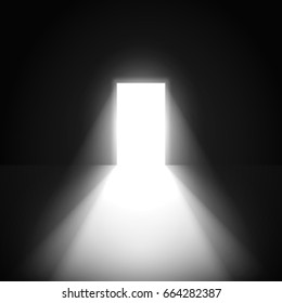 Open door in a dark room with light going through it.
