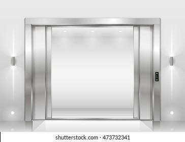 Open door of freight elevator at hospital or office building. Metal armored sliding door.
