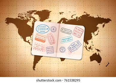 Open foreign passport with international visa stamps on ancient world map on old textured paper