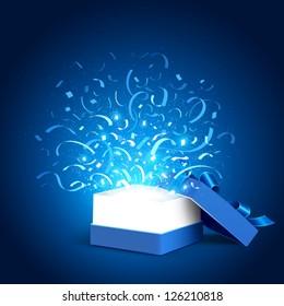 Open holiday box and confetti