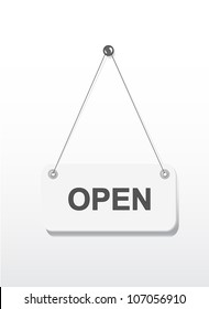 Open sign board hanging on white wall