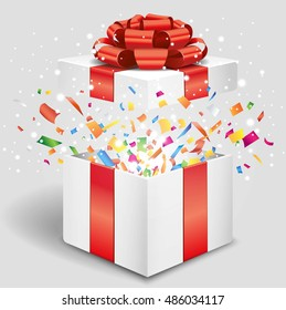 Opened gift box with red bow and confetti