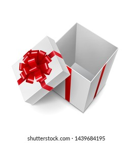 Opened white cube shaped gift box with shiny red ribbon. New year and Chrismas surprise with tape decoration. Side view of realistic empty container isolated on white vector illustration