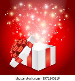 Opened white gift box with red bow and glowing lights