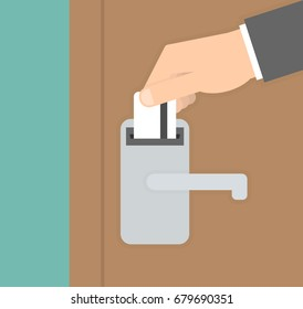 Opening hotel door concept. Hand inserting or putting key card in the lock