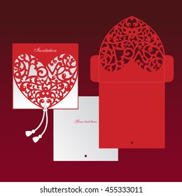 Openwork  red heart. Laser cut template. Cut out envelope. An invitation to the event.