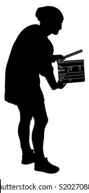 Operator holding clapperboard during the production of film vector silhouette illustration. Film-making or film production concept. Film worker on set. Movie scene start. Behind the scene. Clapper.