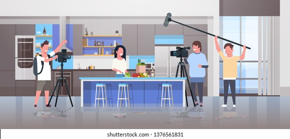 operators using video camera recording food blogger woman preparing tasty dishes videographers using professional equipment cooking blog film production concept kitchen interior horizontal