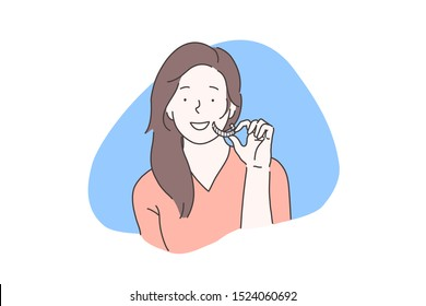 Oral cavity homecare, teeth whitening concept. Smiling girl using dental whitener, young woman holding individual stomatological tooth bleaching tray. Simple flat vector