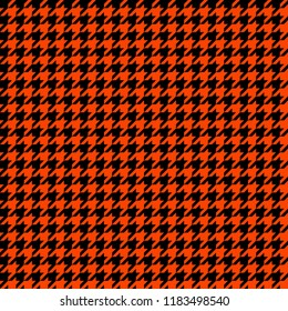 Orange and Black Houndstooth Tartan Seamless Vector Pattern Tile. Halloween Background. High Fashion Textile Print. Dog tooth Check Fabric Texture. Pattern Tile Swatch Included.