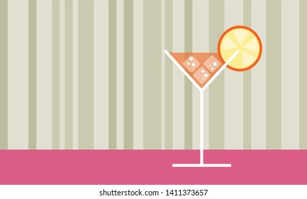Orange cocktail glass drink with ice cubes, bubbles and orange slice