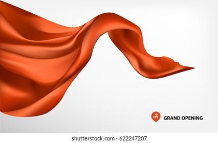 Orange flying silk fabric on white background for grand opening ceremony