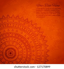 Orange mandala ornament background with space for your text..