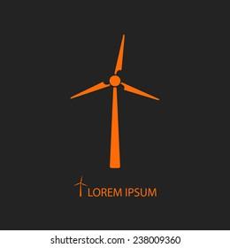 Orange wind turbine as logo with copyspace on black background