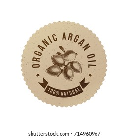 Organic argan oil emblem with hand drawn nuts in eco friendly style. Vector illustration