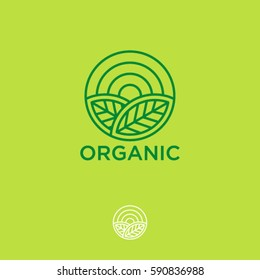 Organic logo. Farmer products emblem. Leaves and sun in a circle.