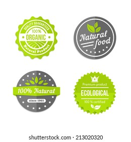 Organic  natural and eco food icons set with round labels in grey  white and green with text - Organic - Natural Food - 100 percent Natural - Ecological - with stylized leaves or crops