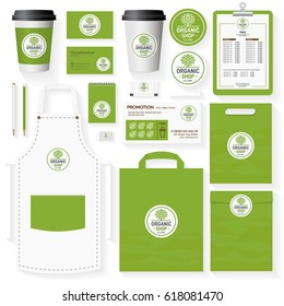Organic shop corporate identity template set with tree logo for use healthy food store, vegan shop, vegetarian cafe, natural product firm, eco market etc. Set of card, menu, package, uniform.