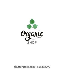 Organic shop. Eco badge with handwritten text and leaves in watercolor style. Logo green color template with floral element for bag, sticker, menu, food package design.