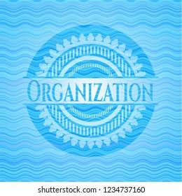 Organization sky blue water wave badge.