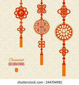 Oriental Asian red and golden tassel decorations. Lotus image, yin yang symbol and knot elements. Stamp with a Chinese hieroglyph for 'joy'. Asian seamless background with knot compositions. Vector