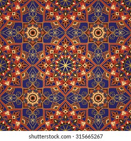 Oriental bright ornament with gold contours. Seamless vector ornate background. Pattern of mandalas in red and blue color. Colorful template for fabric.