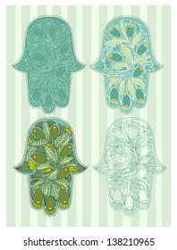 Oriental hamsa hands set with olives decoration