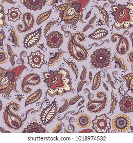 Oriental paisley seamless pattern with traditional persian buta motif and mehndi elements on purple background. Colorful vector illustration for textile print, wallpaper, wrapping paper, backdrop.
