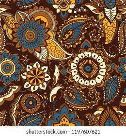 Oriental seamless pattern with ethnic buta motifs and Persian floral mehndi elements on brown background. Motley decorative vector illustration for textile print, wallpaper, wrapping paper, backdrop.