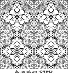 Oriental seamless pattern of mandalas. Vector black and white background. Template for textile, carpet, wallpaper, stained glass, shawls.