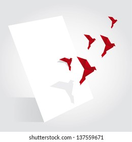 Origami birds flying from paper sheet