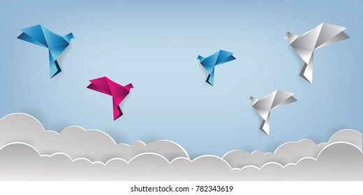 Origami made colorful bird with origami clouds. Paper art and craft style.