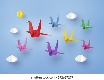 origami made colorful paper bird flying on blue sky with cloud . paper art and craft style.