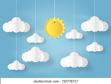 Origami made mobile paper sun and cloud on blue sky background. paper art design and craft style