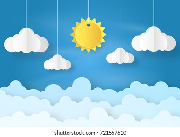 Origami made mobile paper sun and cloud on blue sky background. paper art design and craft style.