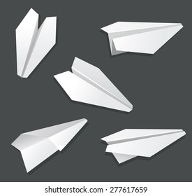 Origami paper airplane toy white on black.