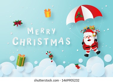 Origami paper art of Santa Claus make a parachute jump on the sky, Merry Christmas and Happy New Year