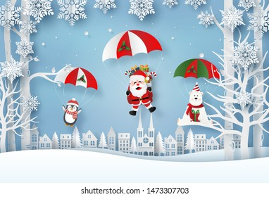 Origami paper art of Santa Claus and Christmas characters a parachute jump in the village, Merry Christmas and Happy New Year