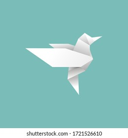 origami paper bird will fly to freedom on blue background.