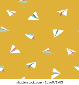 Origami paper planes flying. Bright colorful seamless vector pattern. Small white planes on yellow background. Ideal for summer shirts and dresses, kids wear, bags, textile, paper, stationery.
