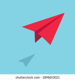 Origami Red paper plane flying in the sky;Startup concept