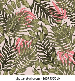 Original seamless tropical pattern with bright leaves and plants on a pastel background. Modern abstract design for fabric, paper, interior decor. Hawaiian style.
