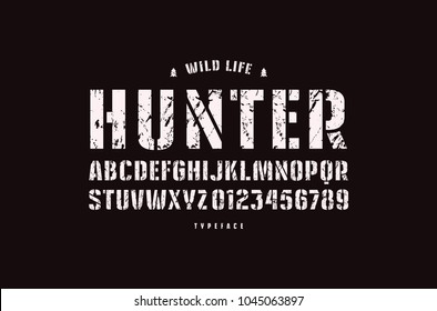 Original stencil-plate sans serif font. Bold face. Letters and numbers with rough texture for logo and emblem design. White print on black background